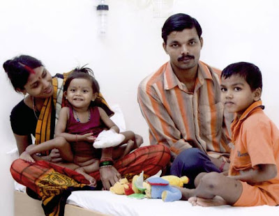 Lakshmi Tatma with her father, mother, and brother