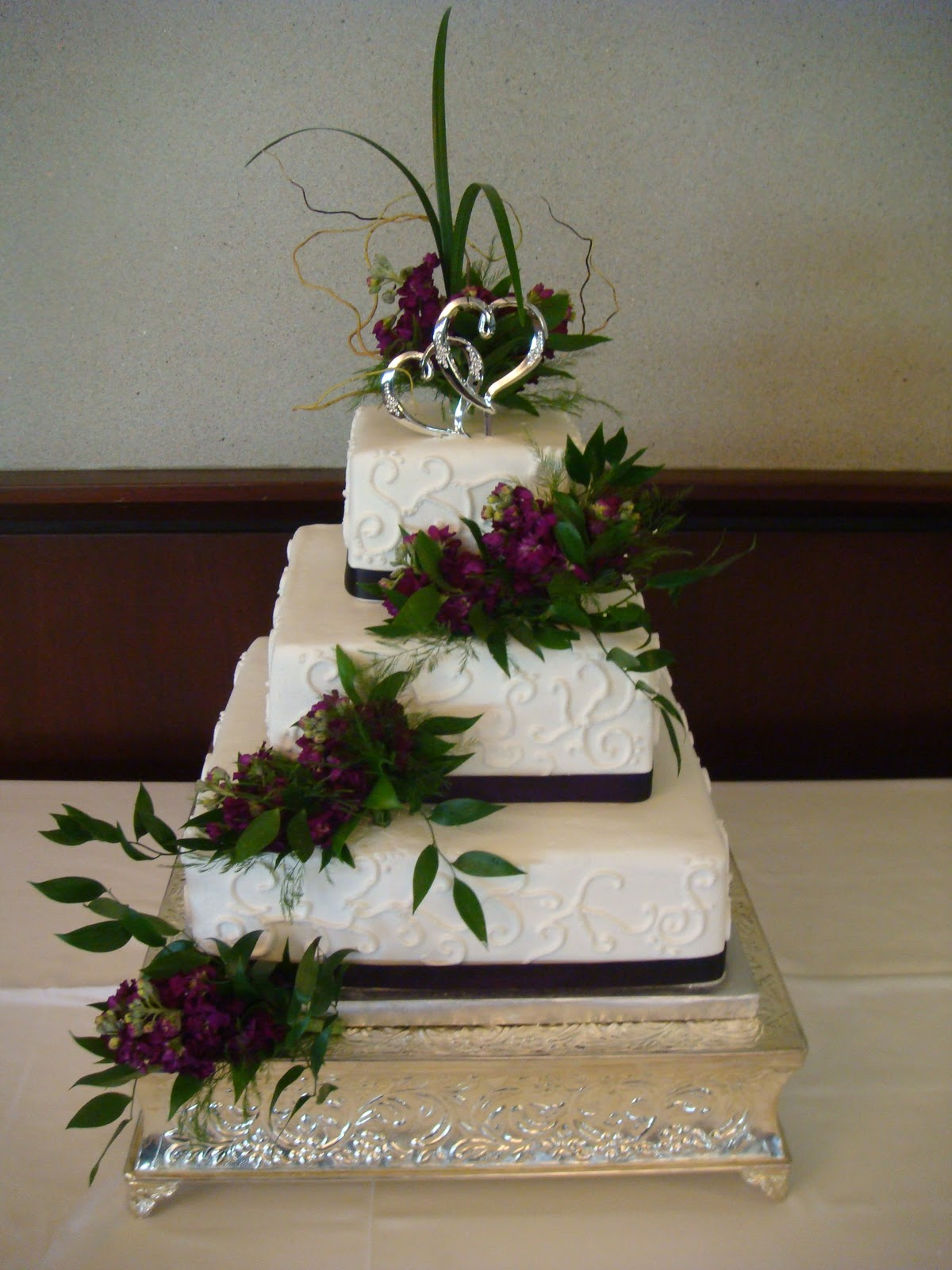 """This six layer cake is a """"Mad Hatter"""" theme cake decorated in ..."""