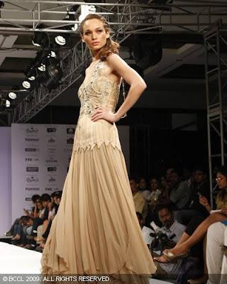 Models display work by Mandira Wirk