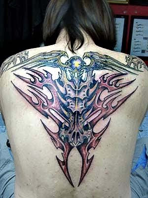 Biomechanical Tattoo on Back Body · Biomechanical Tattoo on Back Body