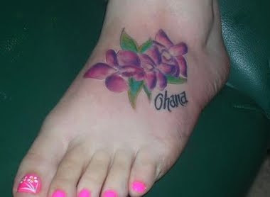 cute orchid tattoo on feet