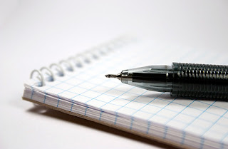 photo of a pencil and paper
