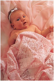 baby in pink sheets