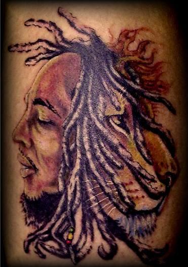Deceased pet tattoo fail. It resembles an infectious tattoo bob marley