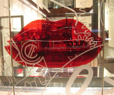 Red lips on 57th Street at Tag Heuer