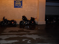 Motorcycles park in front of the doors