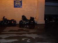 Motorcycles park in front of the doors