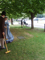 Mother and Fathers of Confederation playing croquet on the lawn