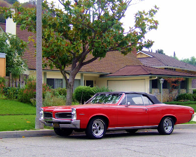 old+car+red+pontiac+convertible+in+hills Curb Appeal  photo