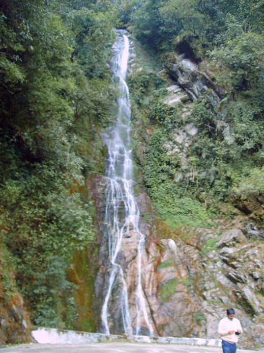 Waterfalls forming human figure on the rock