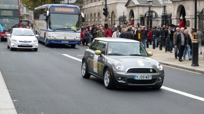Mini E and Auris Hybrid drive up Whitehall