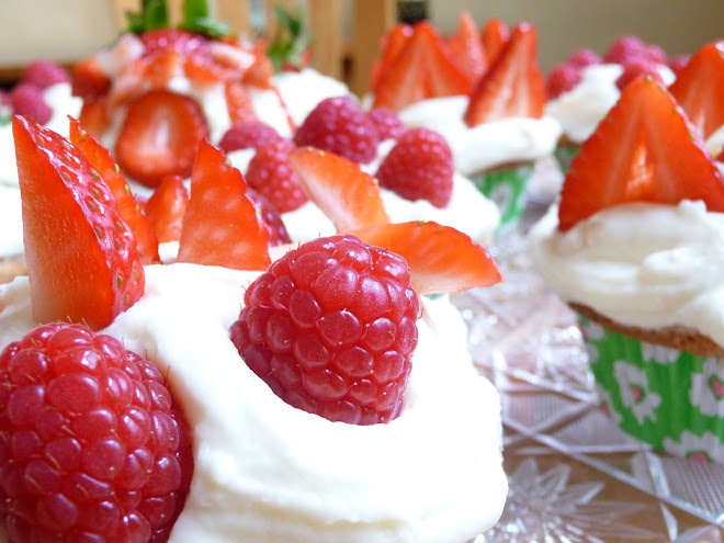 Fresh Strawberry Slices & Whole Raspberries tucked into cream cheese frosted vanilla cupcakes