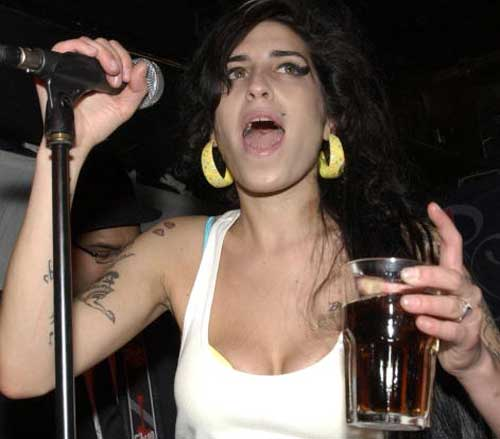 Amy-Winehouse-cleavage-sitting-pose
