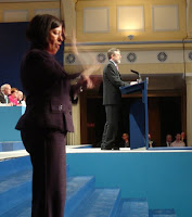 A sign language interpreter suddenly appeared at the start of Gerry Adams' closing speech