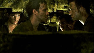 Still image of the crew inside the tank from the film Lebanon (2009)