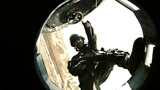 Still image of Gamil about to get into a tank from the film Lebanon (2009)