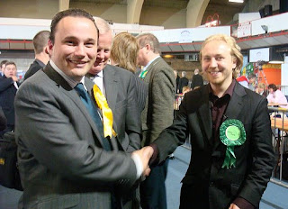 Alliance candidate Ian Parsley and Green's Steven Agnew shaking hands after being excluded from the count