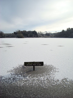 Hillsborough lake - sign at edge of frozen lake saying No Fly Fishing Beyond This Point