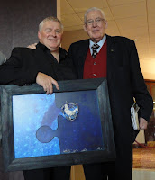Artist Ian Fleming handing his jigsaw artwork to Lord Bannside (Ian Paisley) at Ullans Academy's Columbanus Celebration