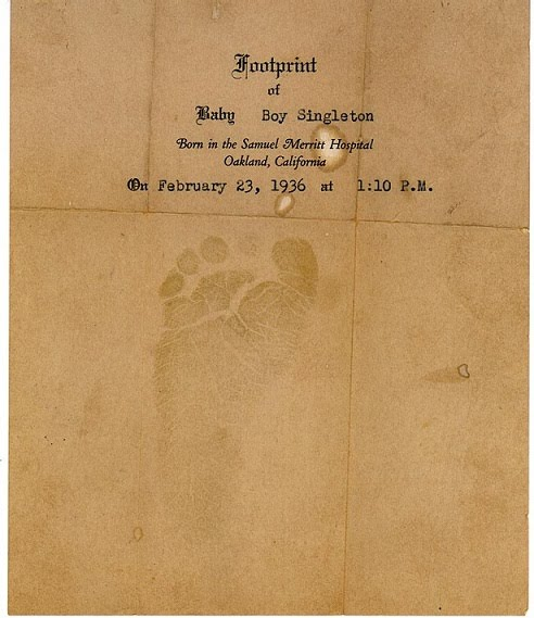 baby handprint tattoos. Brown aby footprint
