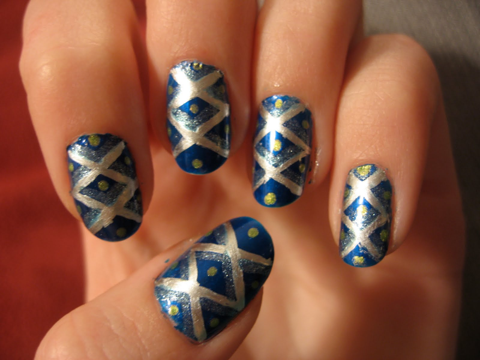 Silver And Blue Criss Cross Nails