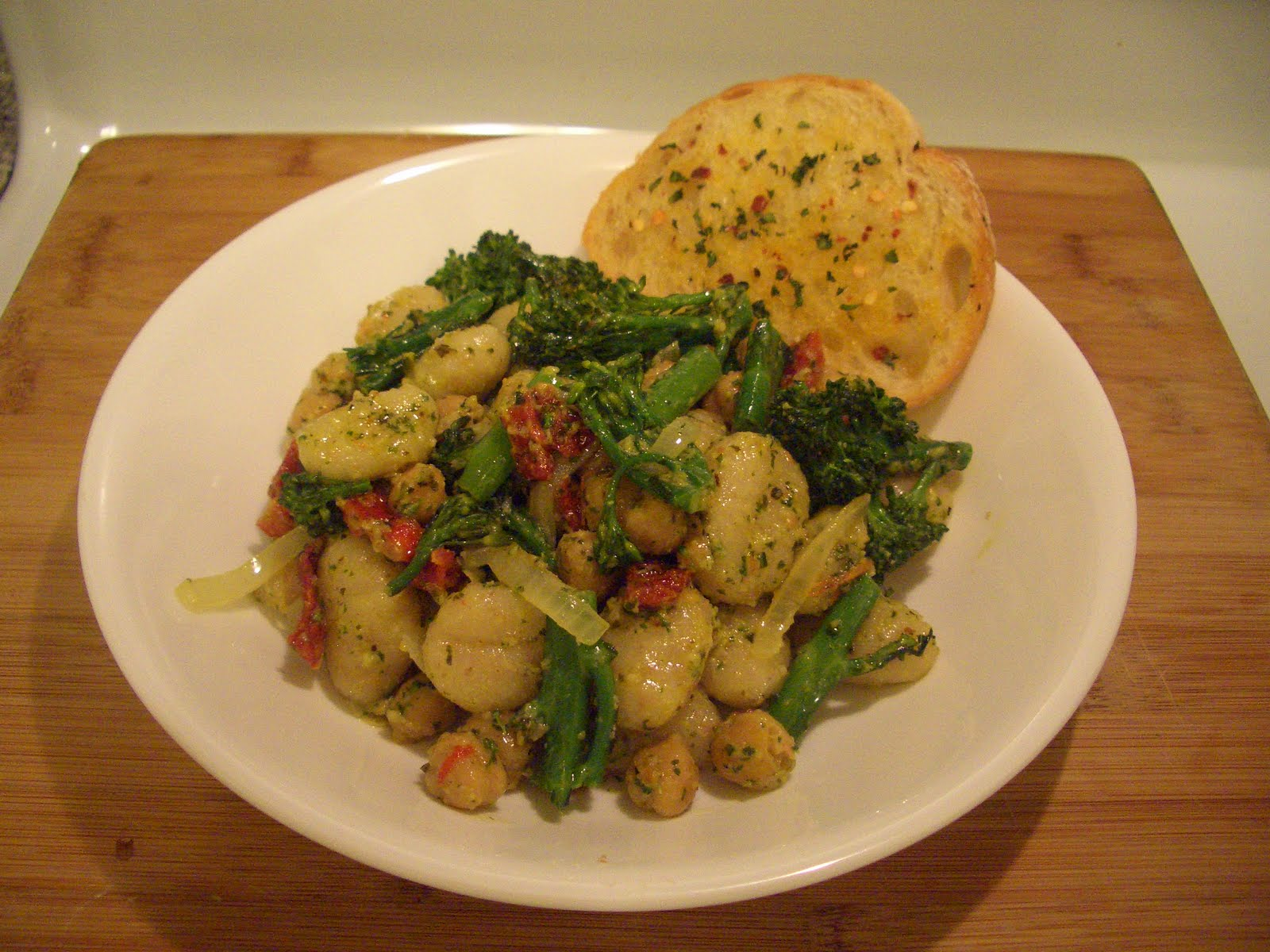 Invariably Vegan: Pesto Gnocchi with Sundried Tomatoes and Broccolini