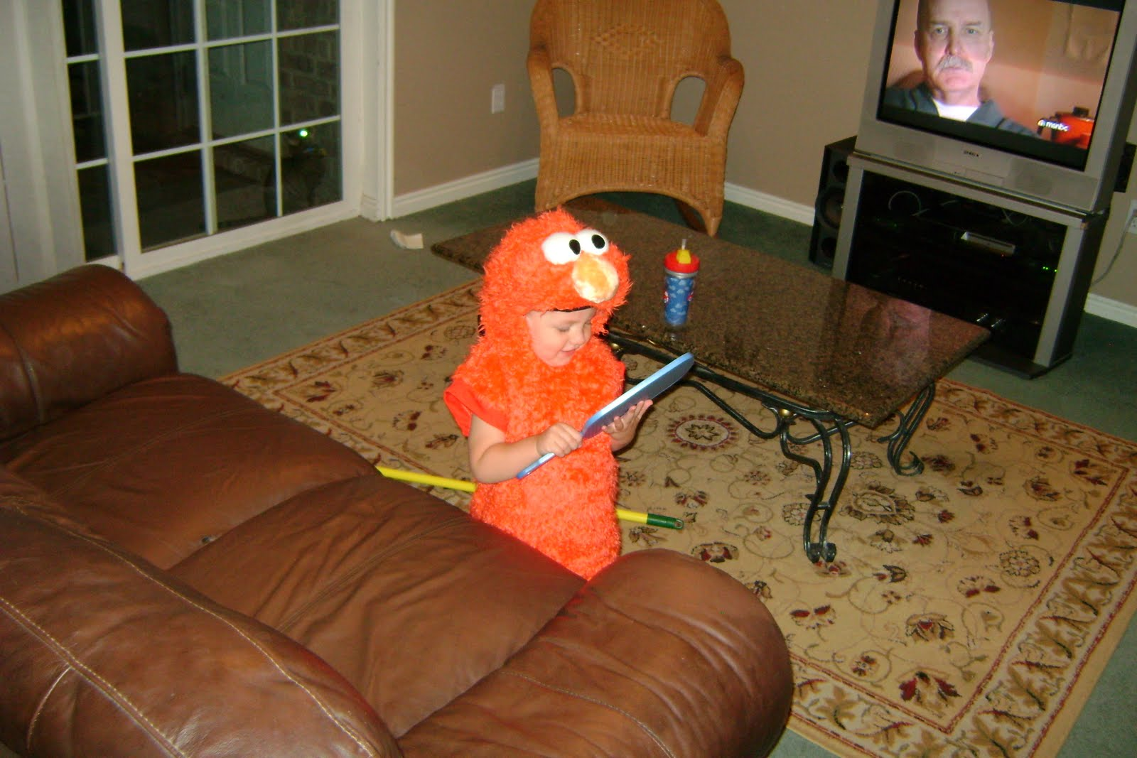 Niko wanted to be Elmo for Halloween. This is the first time he tried on the ...
