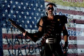 Παιχνίδι με ταινίες - Σελίδα 3 Watchmen_comedian_gal