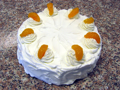 Mandarin orange layer cake frosted with