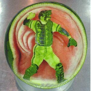 Watermelon carving art - seen at curiousphotos.blogspot.com