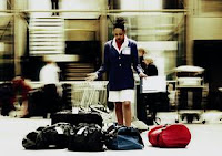 Woman surrounded by luggage