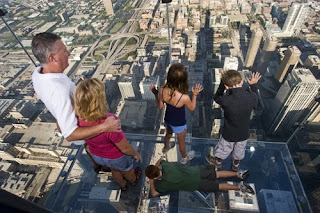 Family in The Ledge glass balcony on Willis Tower, Chicago