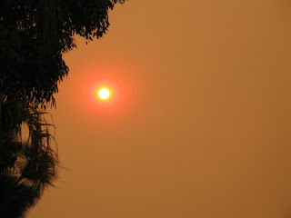 Smoke-veiled afternoon sun in Leucadia from San Diego's Witch Fire