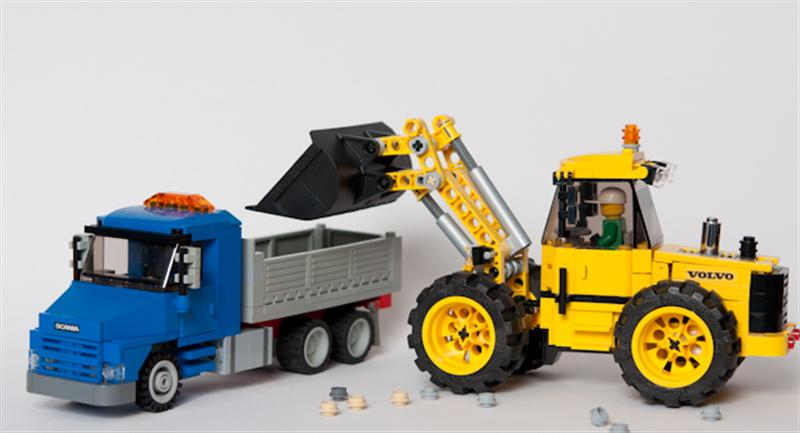 Scania 113H And Volvo Front End Loader