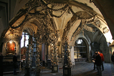 the inside of the ossuary at Kostnice; an ossuary is a building made out of human bones.  Human bones!