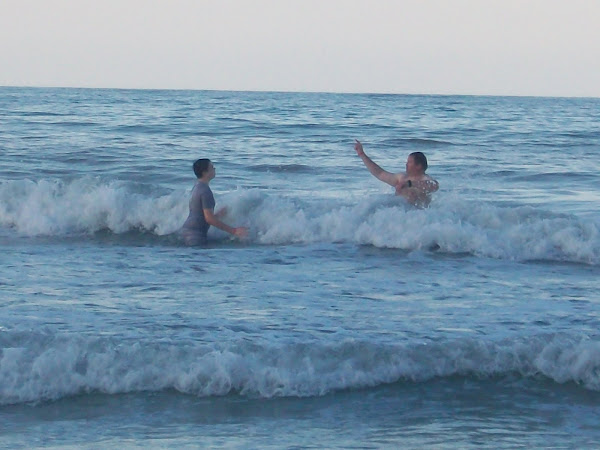 Dad and Joseph playing in the waves