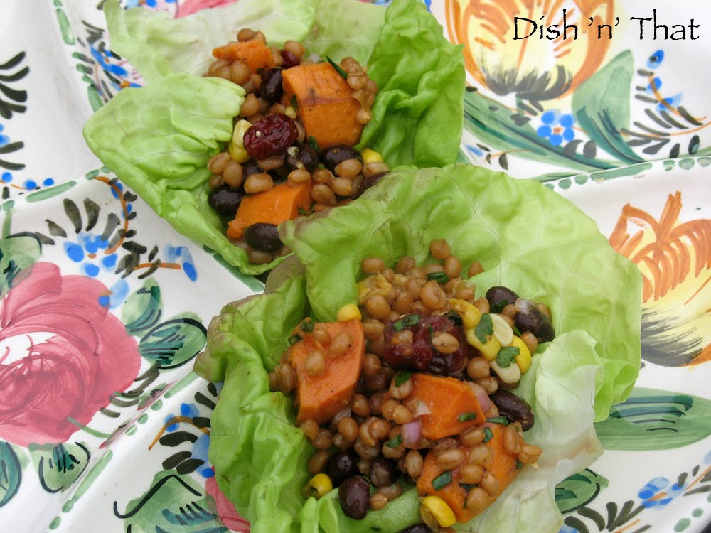 Wheat berry salad with black beans, yams and dried cranberries sit in ...