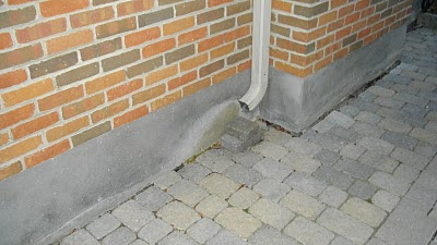 downpipe placement downspout icy walkways trip hazards Toronto