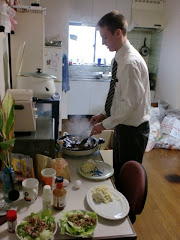 Elder Larsen cooking a feast