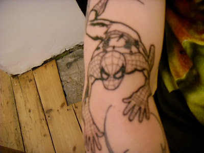 Spiderman tattoos is favorite tattos art design and This is a wicked