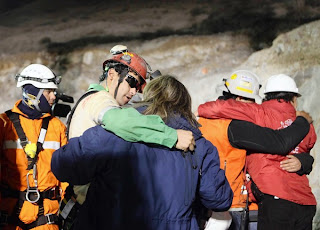 14 of 33 trapped miners are rescued in Chile copper and gold mine