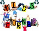 This is a picture of kids in a circle with letters on their shirts. Each student has a letter and together they spell kids corner.