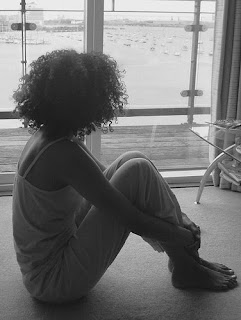 African American adolescent girl in contemplation and partial silhouette