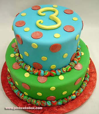 three tiered multi-colored third birthday cake