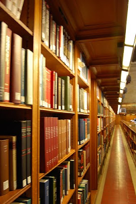 aisle of library showing books