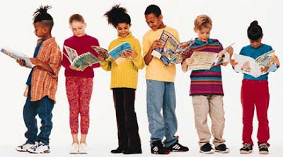 six children in a row reading books and magazines