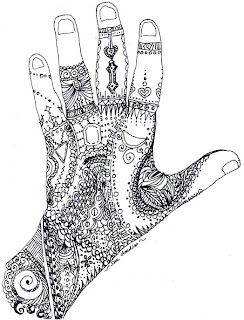 outline of hand filled in with doodles
