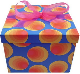 blue gift box with rainbow spots and a large pink ribbon