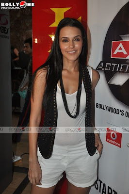 Neha Dhupia is in white dress