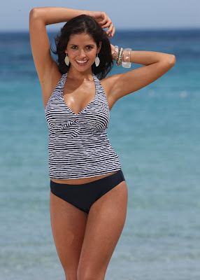 Carla Ossa is in black and white bikini.